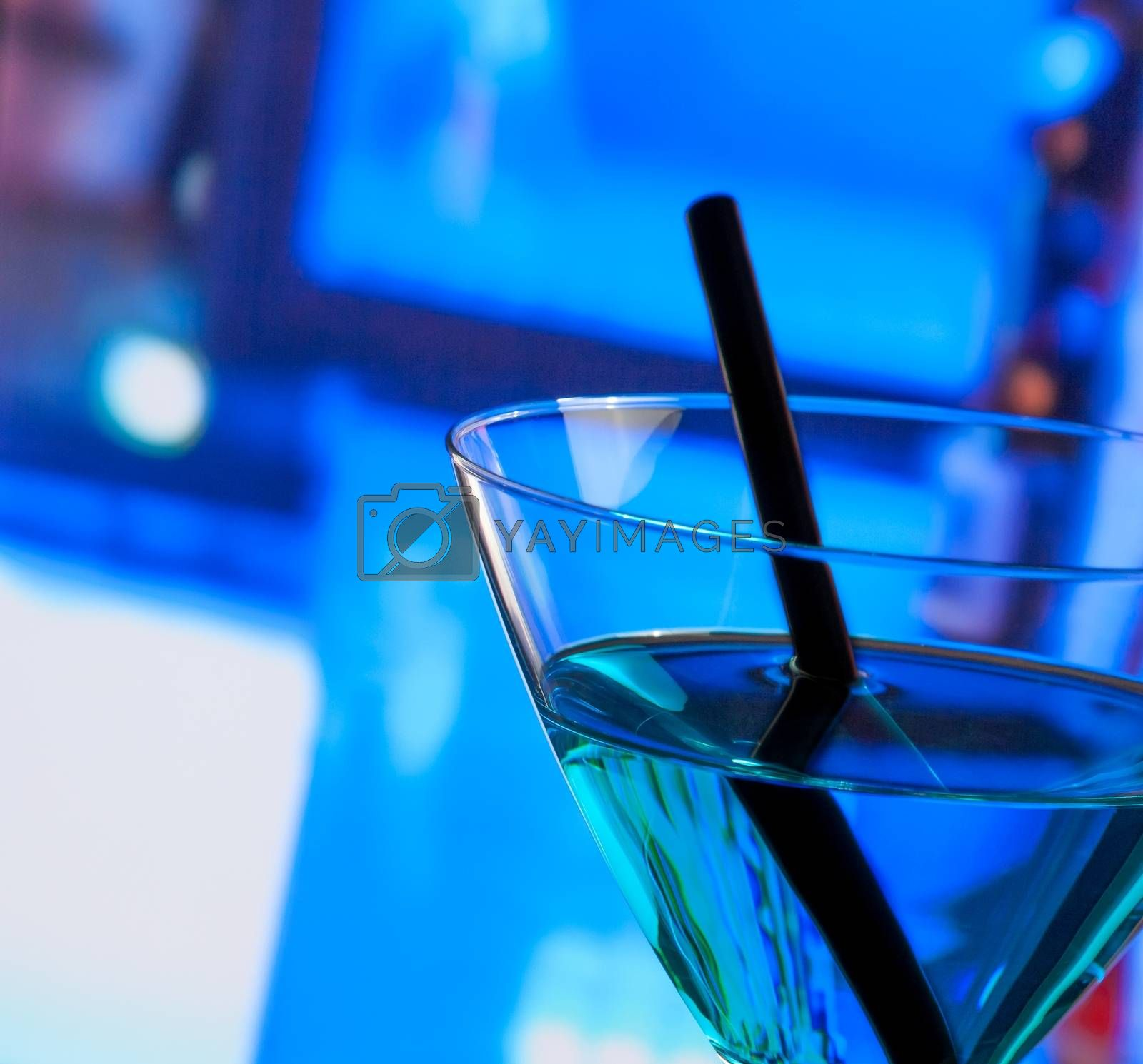 detail of blue cocktail drink on a bar table with space for text by donfiore