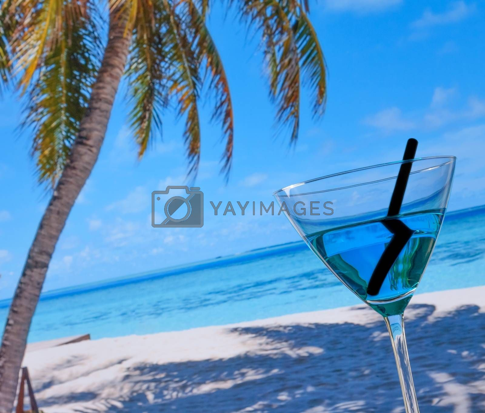 blue cocktail on beach by donfiore