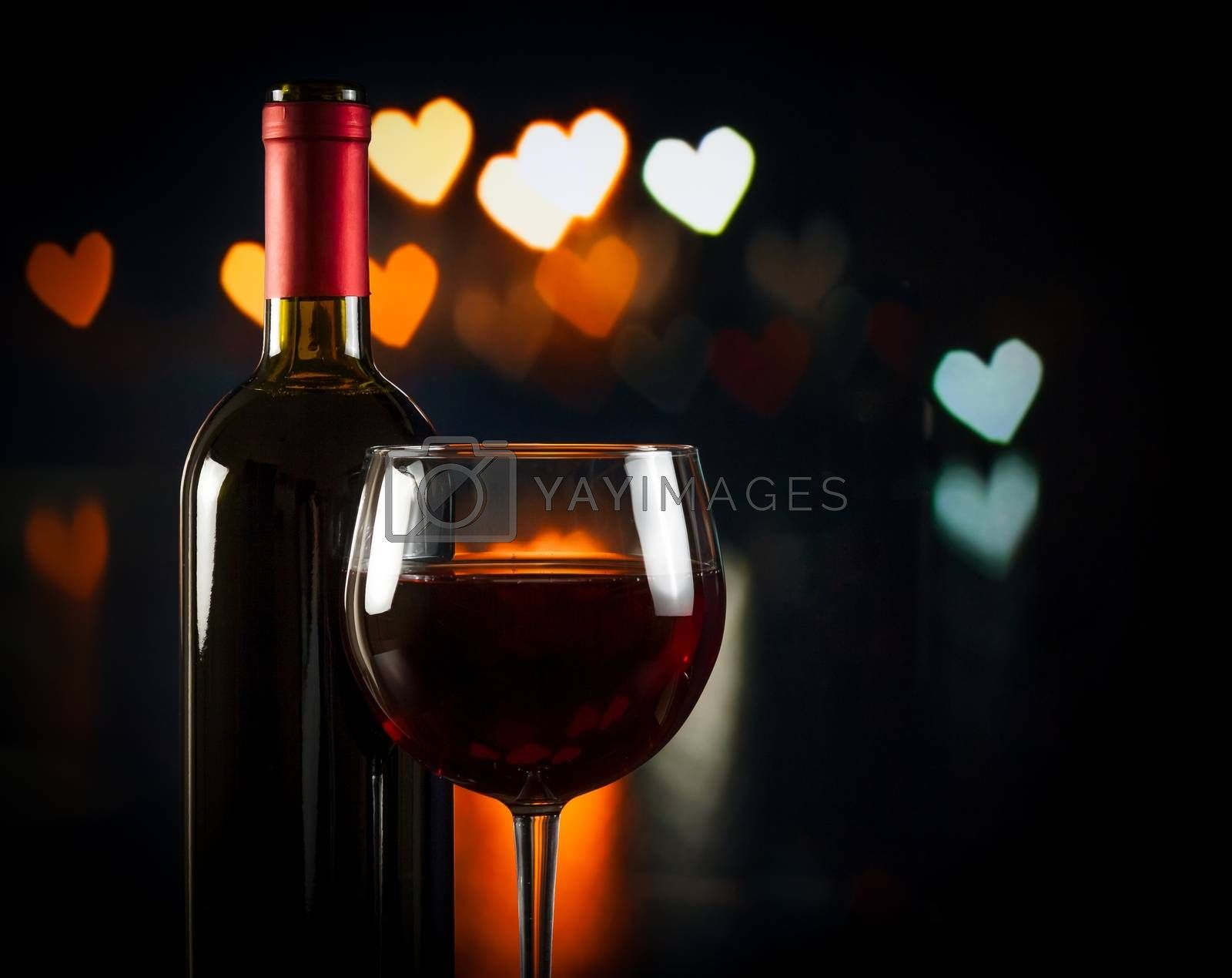 wine glass near bottle, concept of valentine's day by donfiore