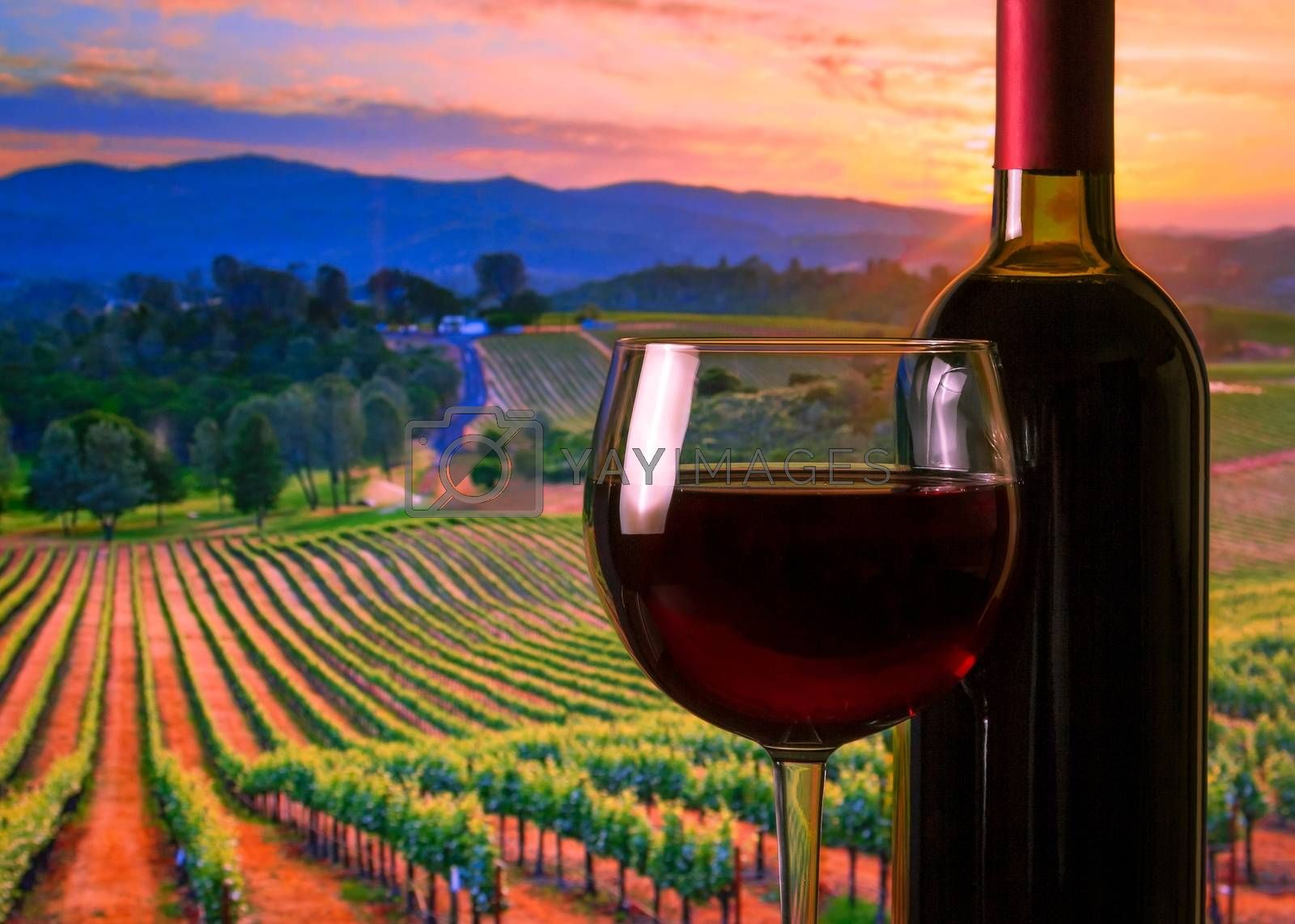 glass with red wine and bottle, atmosphere sunset by donfiore