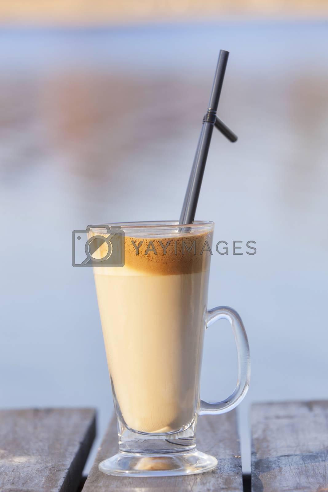 Iced coffee on table by Slast20