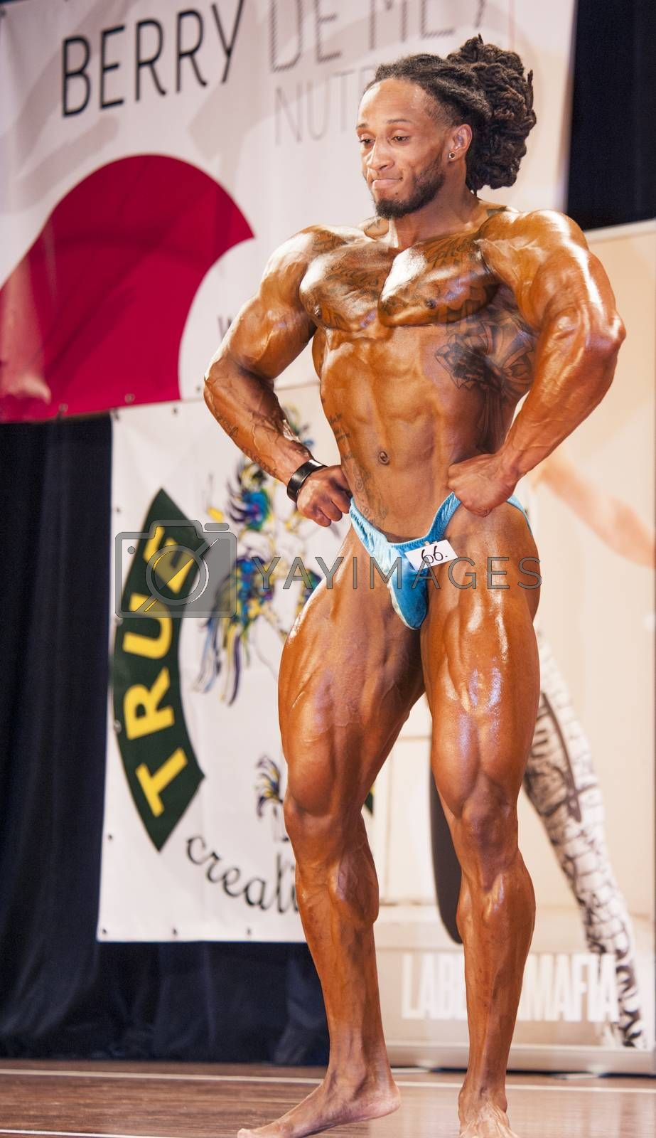 Male bodybuilder Grego Francisca shows his lats spread pose by yellowpaul