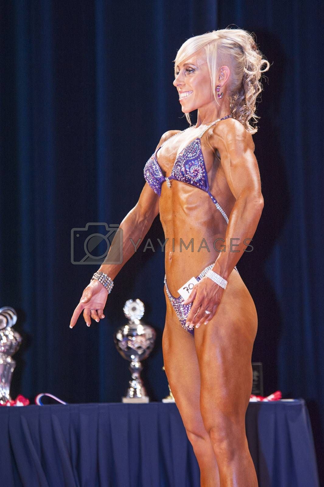 Female bikini contestant shows het best front pose on stage by yellowpaul