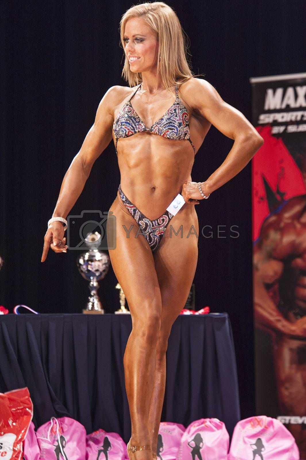 Female bodyfitness contestant shows het best front pose by yellowpaul