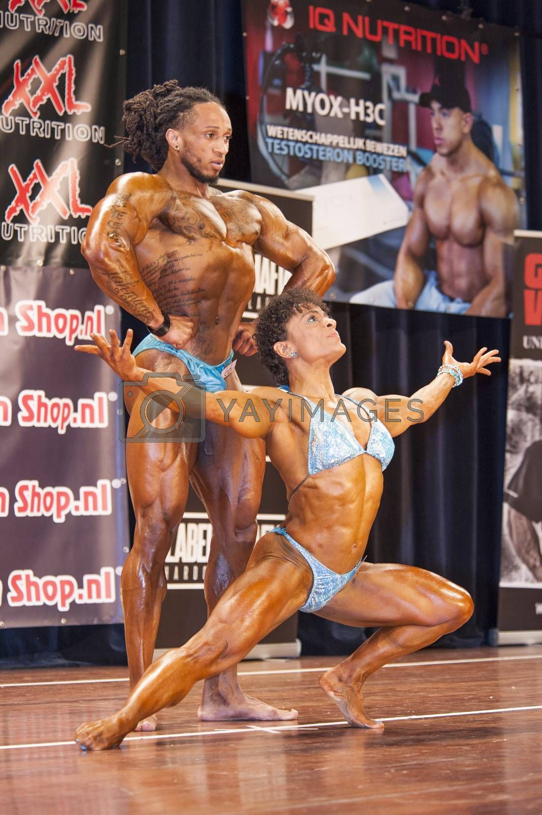 bodybuilding duoshowing their puscular body on stage by yellowpaul
