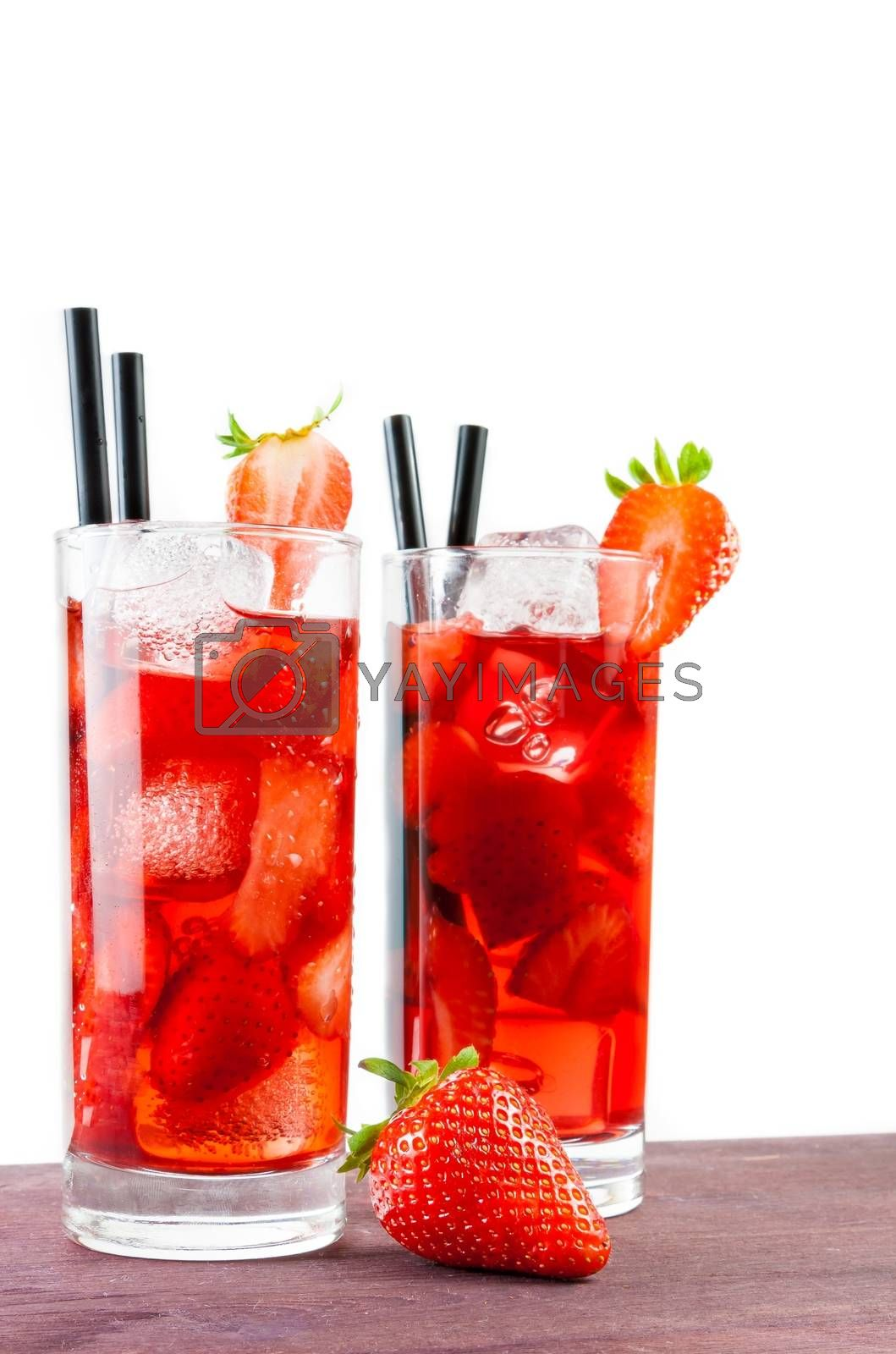 two glasses of strawberry cocktail with ice and strawberry on top by donfiore