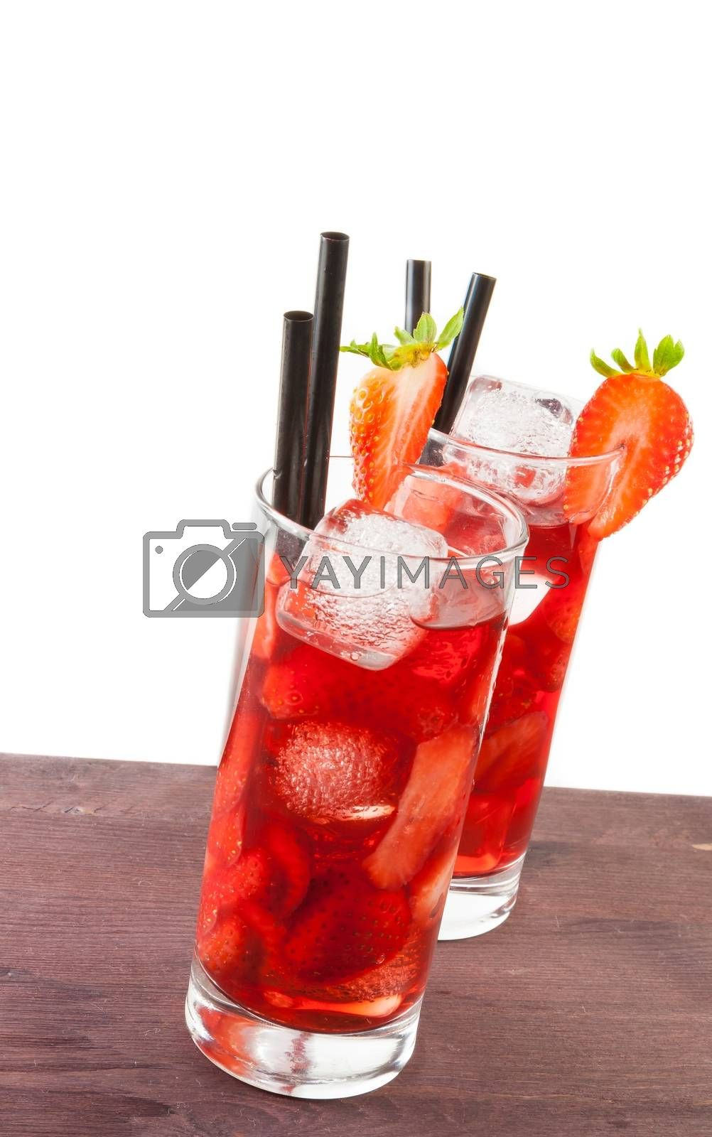 two glasses of strawberry cocktail with ice on white background by donfiore