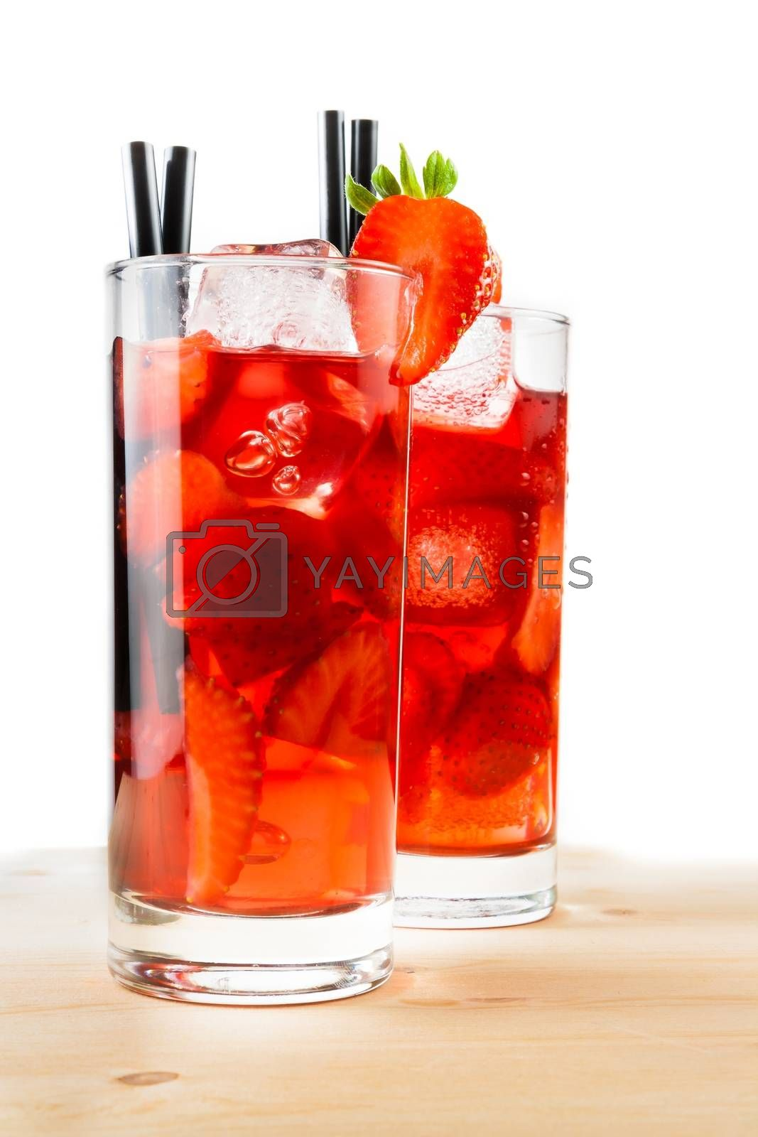 glasses of strawberry cocktail with ice on light wood table  by donfiore