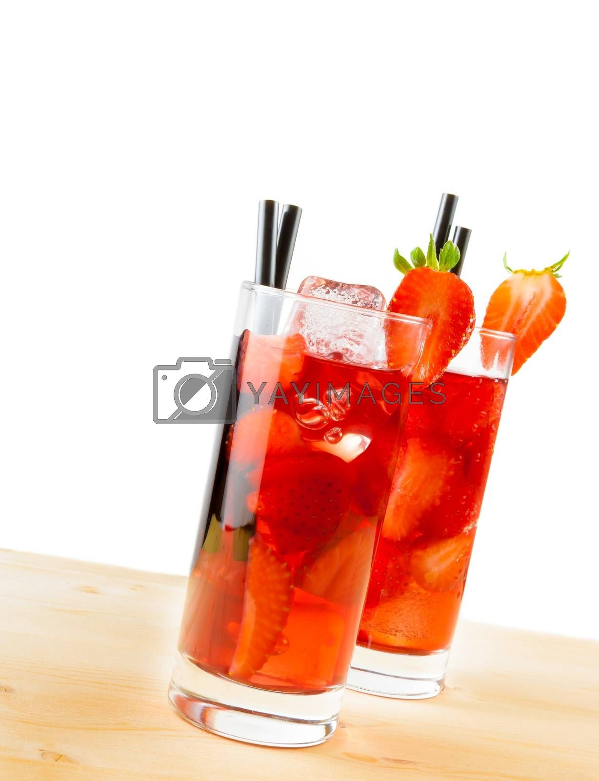 two glasses of strawberry cocktail with ice on light wood table  by donfiore