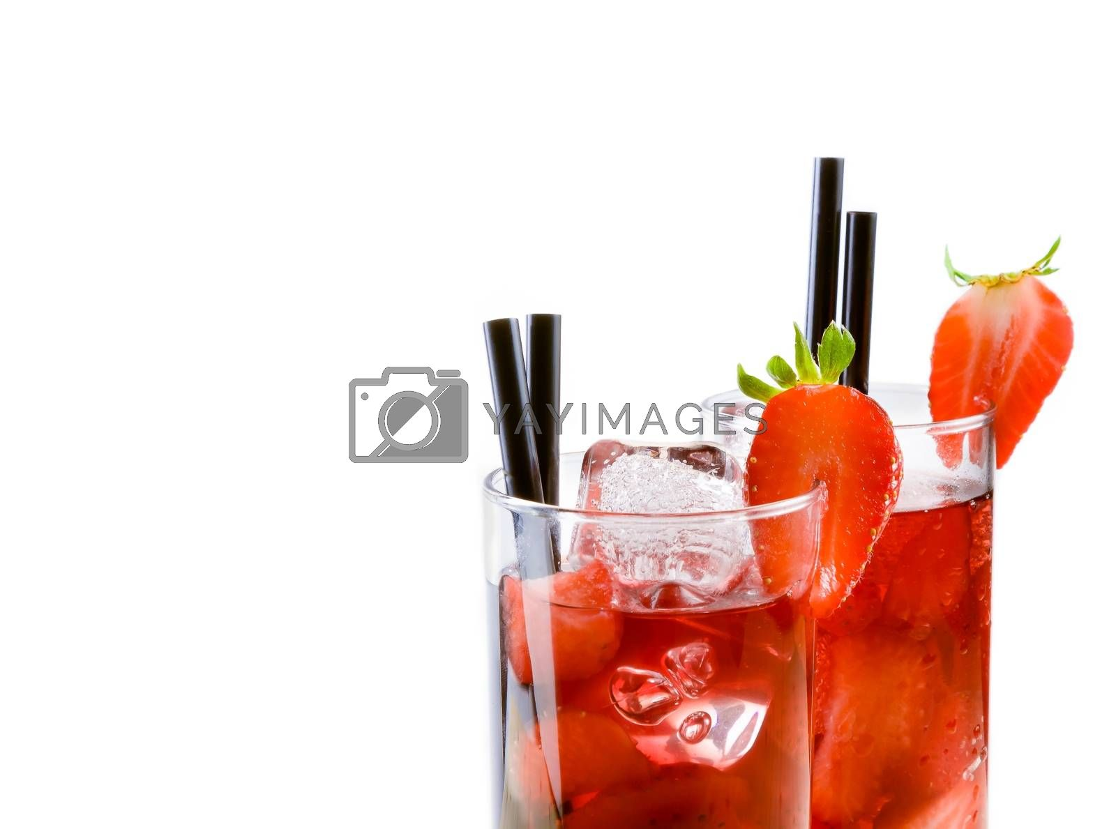 detail of glasses of strawberry cocktail with ice isolated with strawberry on top by donfiore