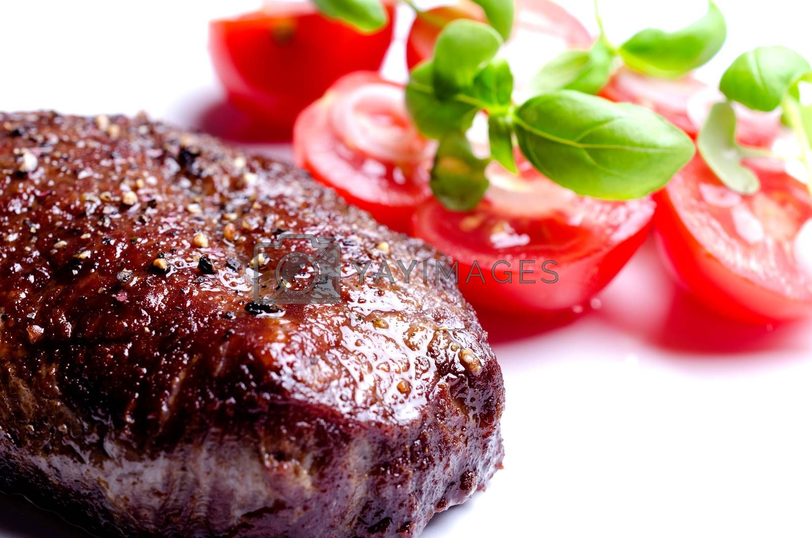 Grilled steak with tomatoes and oregano leafs by Nanisimova