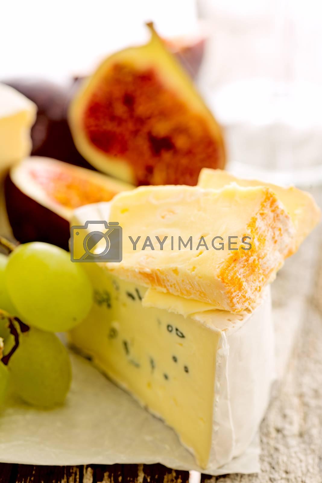 Cheese figs grapes by Nanisimova