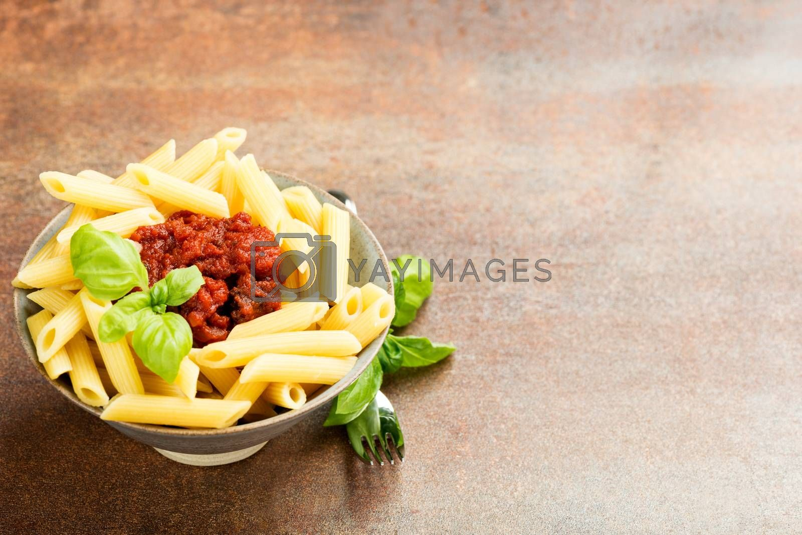Penne pasta with a tomato bolognese beef sauce by Nanisimova