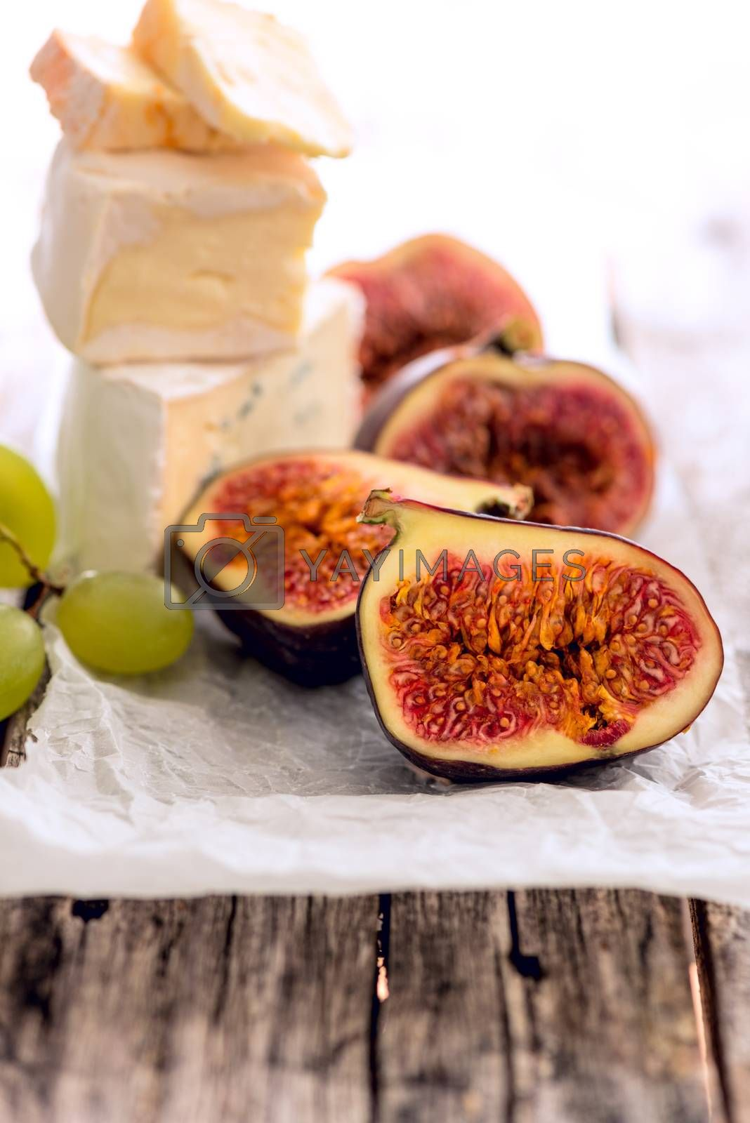 Cheese figs grapes by Nanisimova