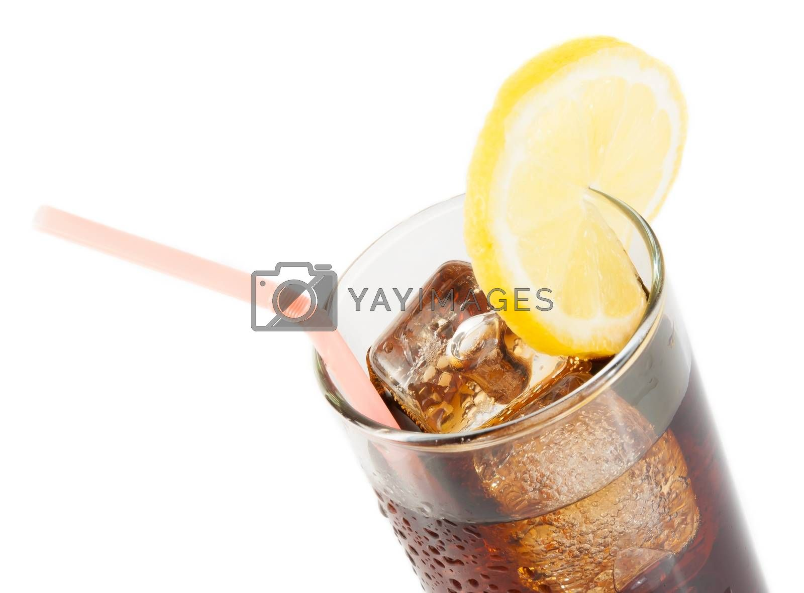 glass of fresh coke with straw with lemon slice on top, summer time by donfiore