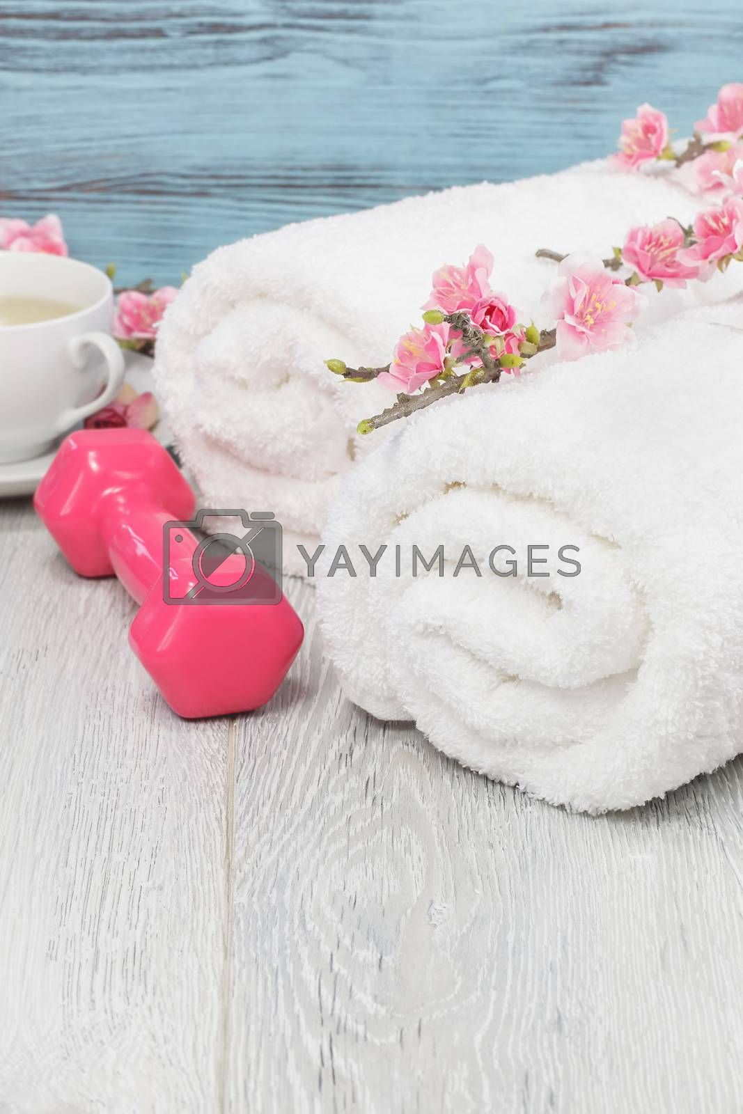 Healthy living concept- hand weight, towels and tea by Slast20