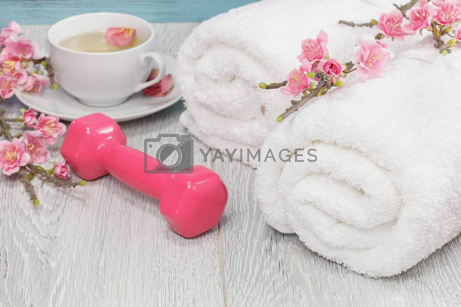 Healthy living concept- hand weight, towels and tea. by Slast20