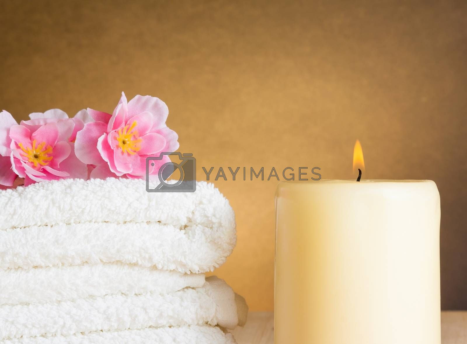 Spa massage border background with towel stacked and candle by donfiore