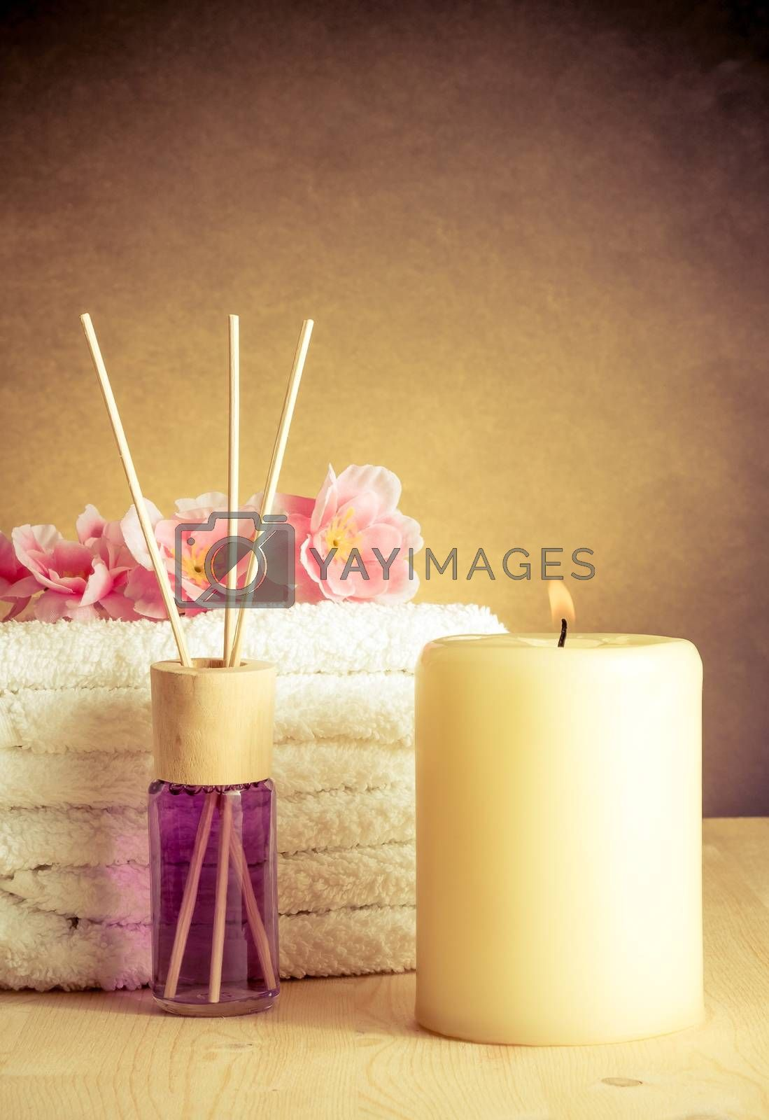Spa massage border background with towel stacked, perfume diffuser by donfiore