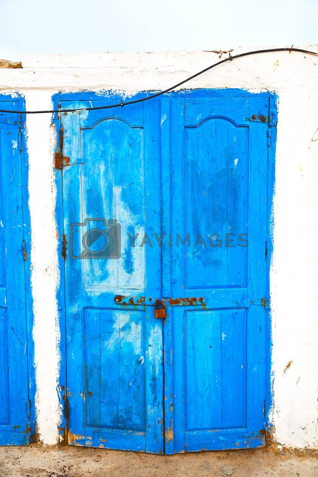 in africa   old harbor wood   door and the blue sky by lkpro
