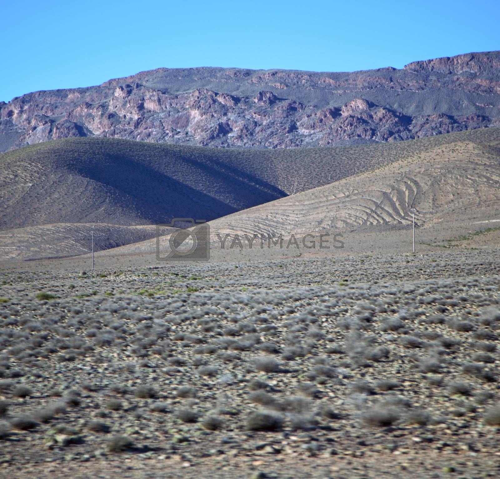 valley hill   in   africa morocco the atlas dry mountain ground  by lkpro