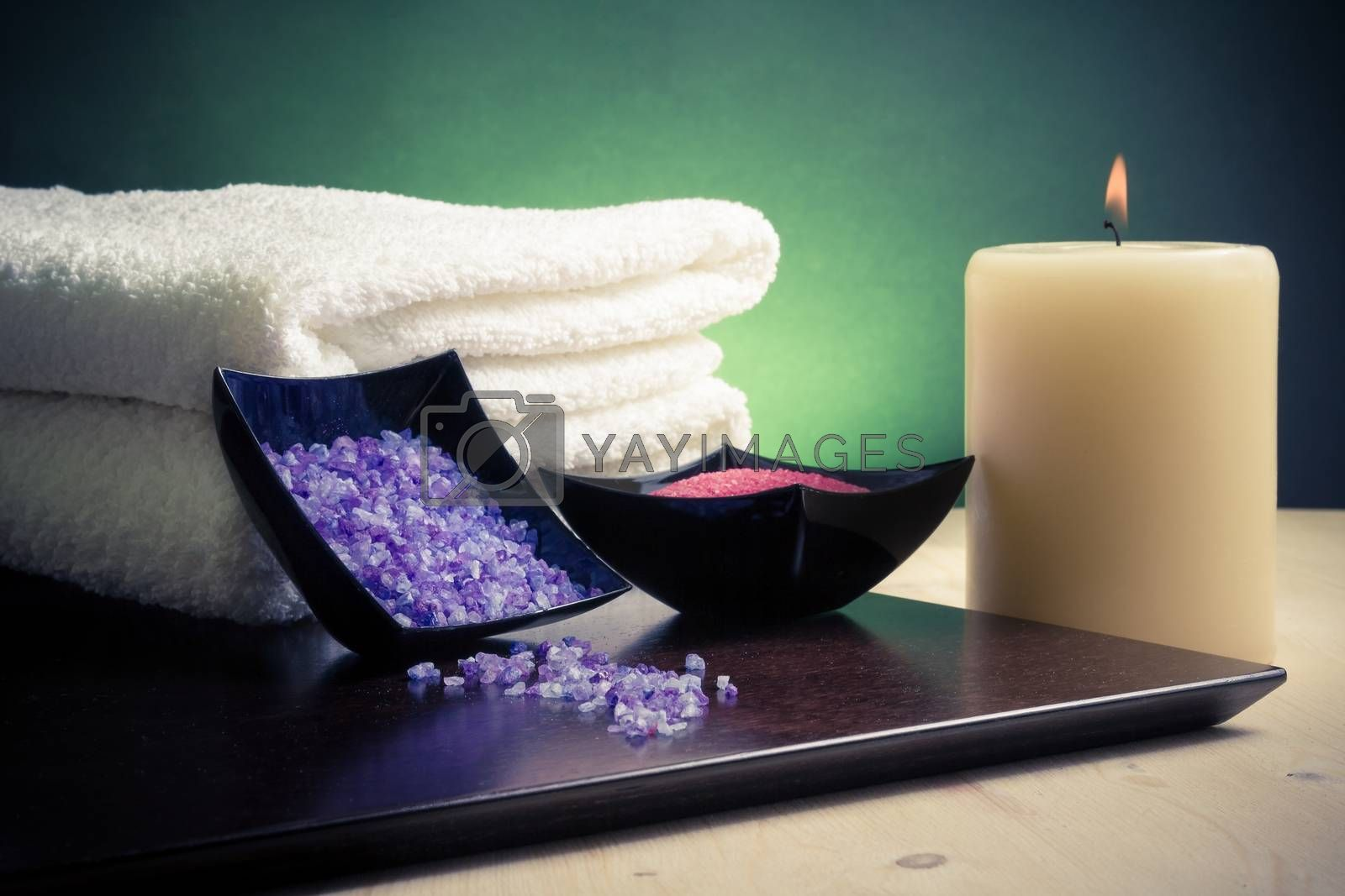 Spa massage border background with towel stacked, candle and sea salt by donfiore