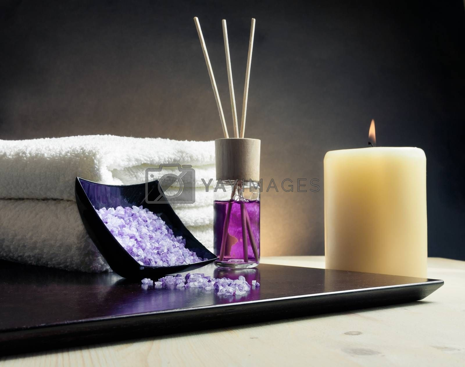 Spa massage border background with towel stacked, perfume diffuser and sea salt by donfiore