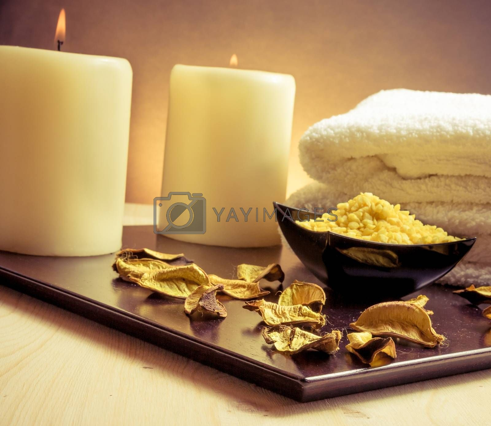 Spa massage border background with towel stacked, perfumed leaves, candle and sea salt by donfiore