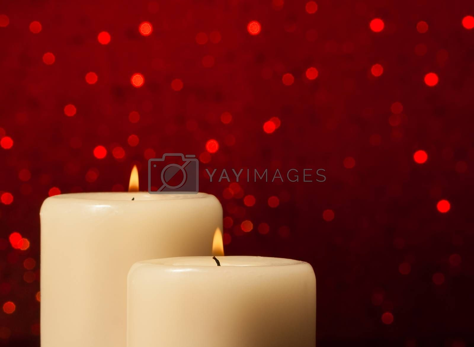 candles with flame and space for text by donfiore