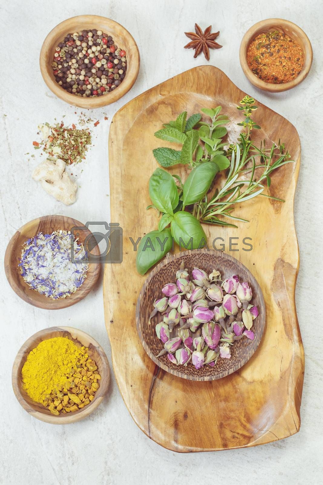 Assorted spices with fresh herbs by Slast20