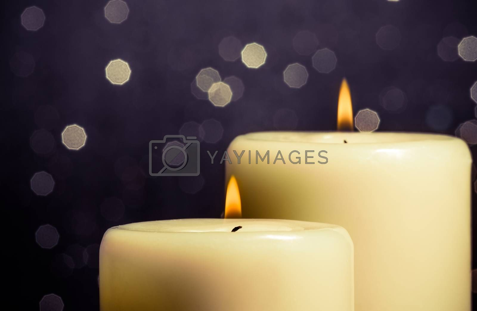 close-up of candles with flame on bokeh by donfiore