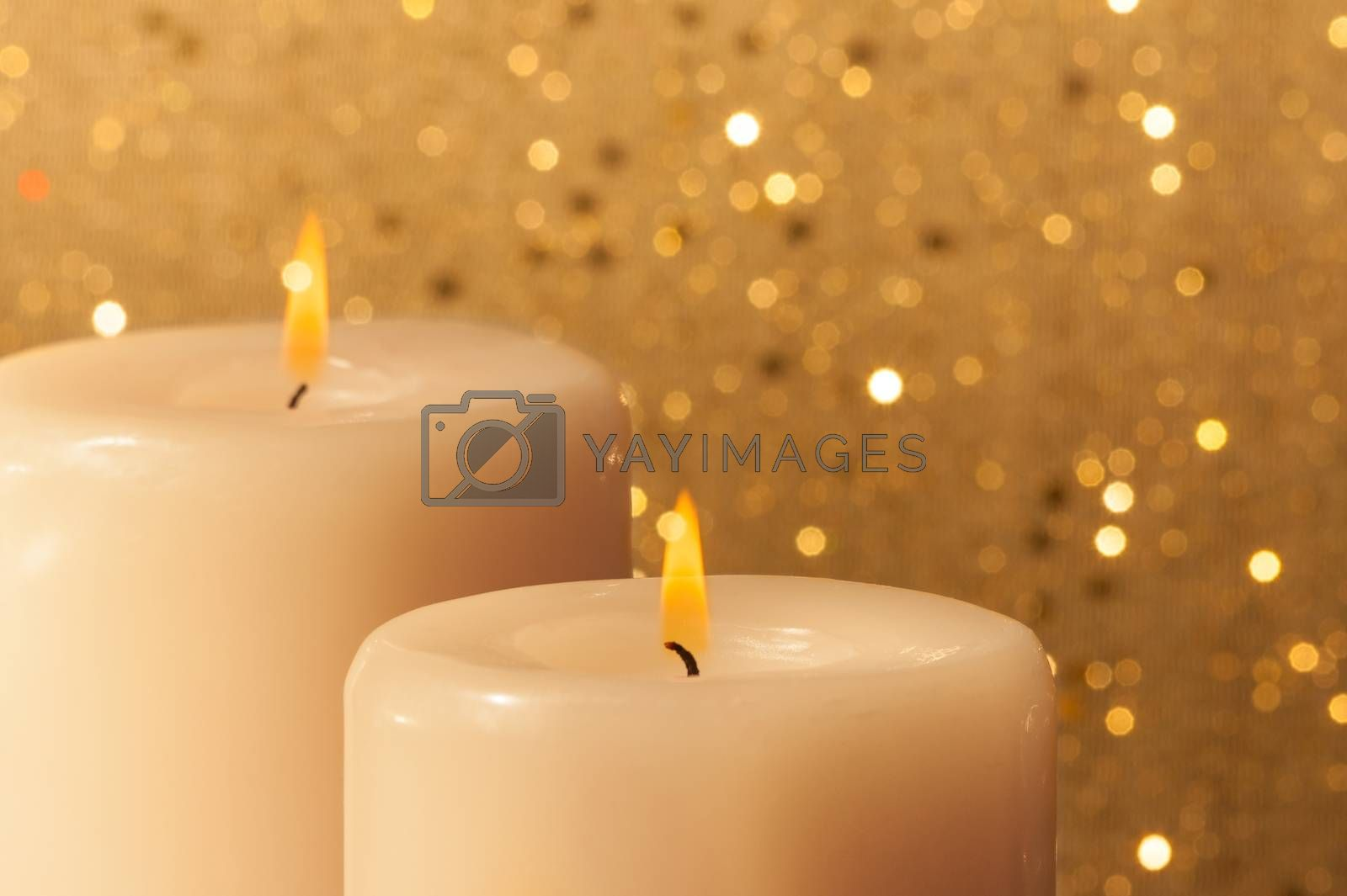 candles with flame on golden bokeh by donfiore