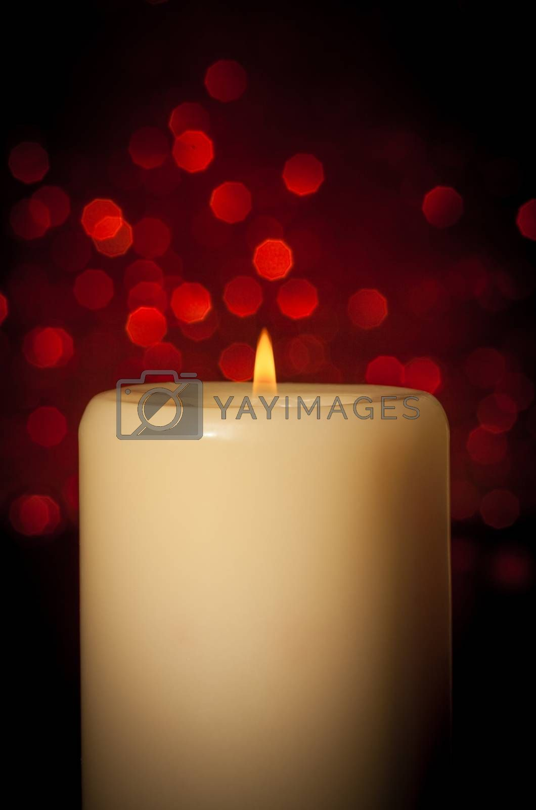 candle with flame on wood table, christmas theme by donfiore