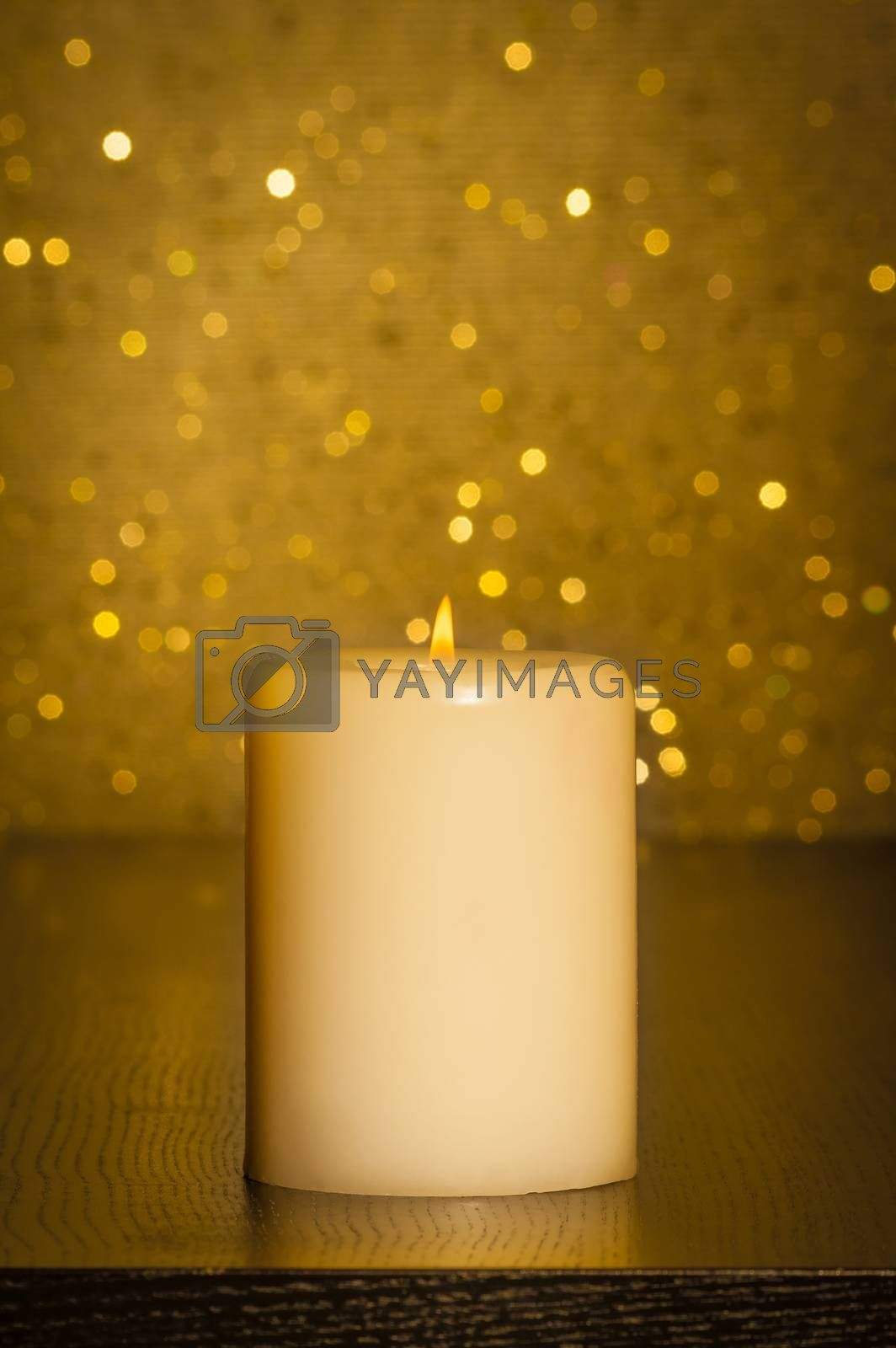 candle with flame on wood table by donfiore