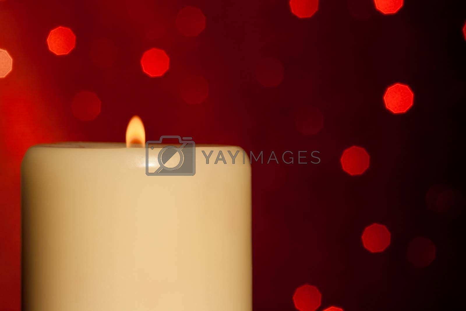 half candle with flame on wood table, christmas theme by donfiore