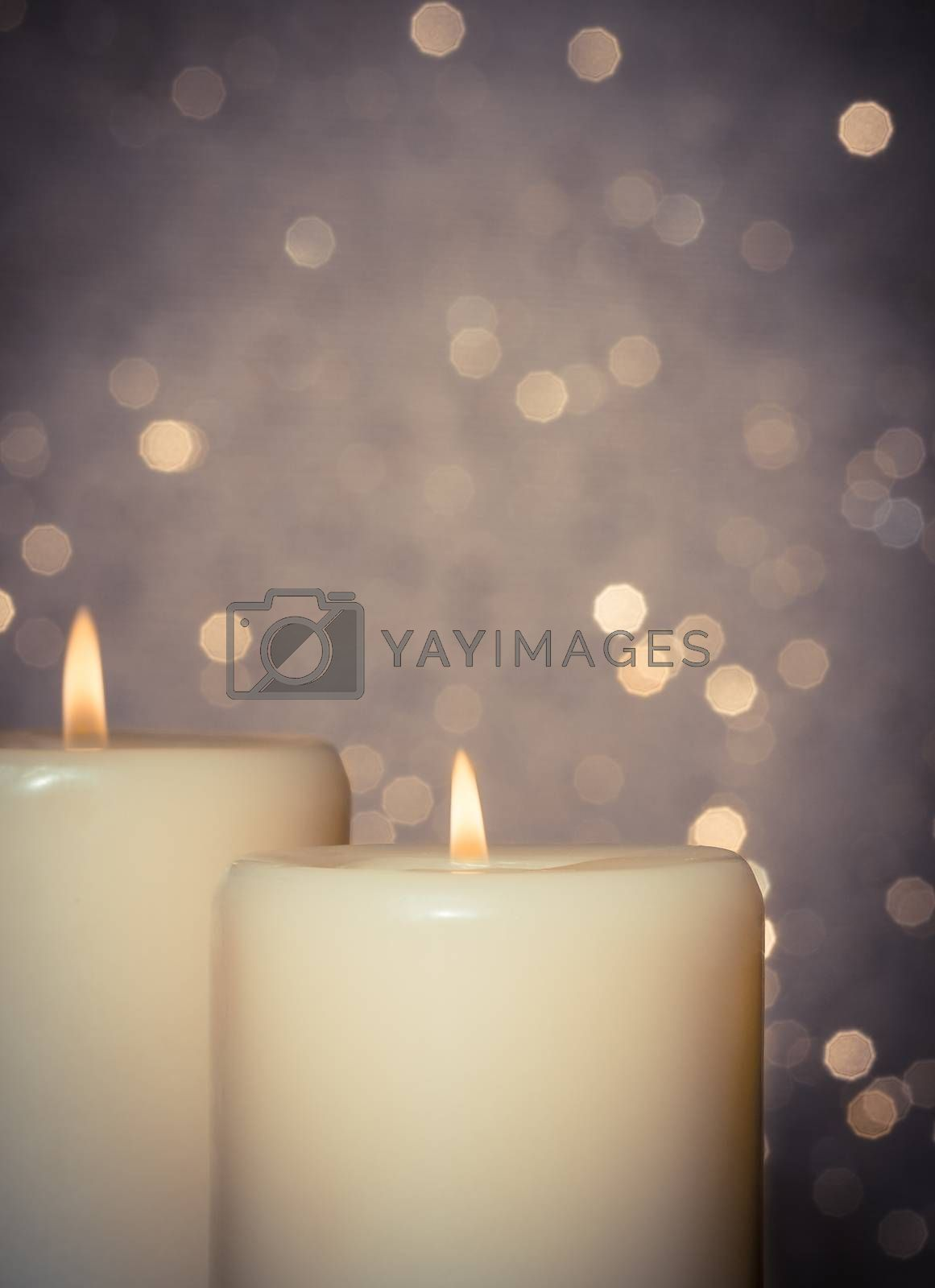 candles with flame on bokeh by donfiore