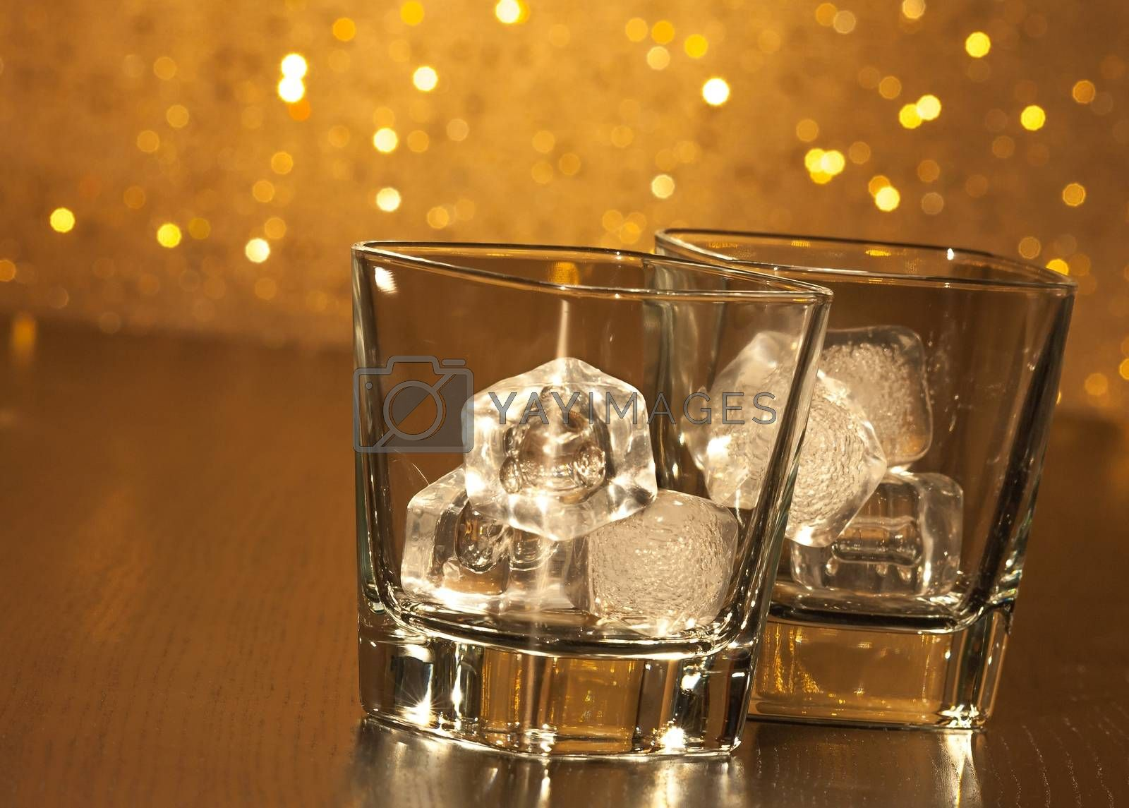 two empty whiskey glasses on wood table by donfiore