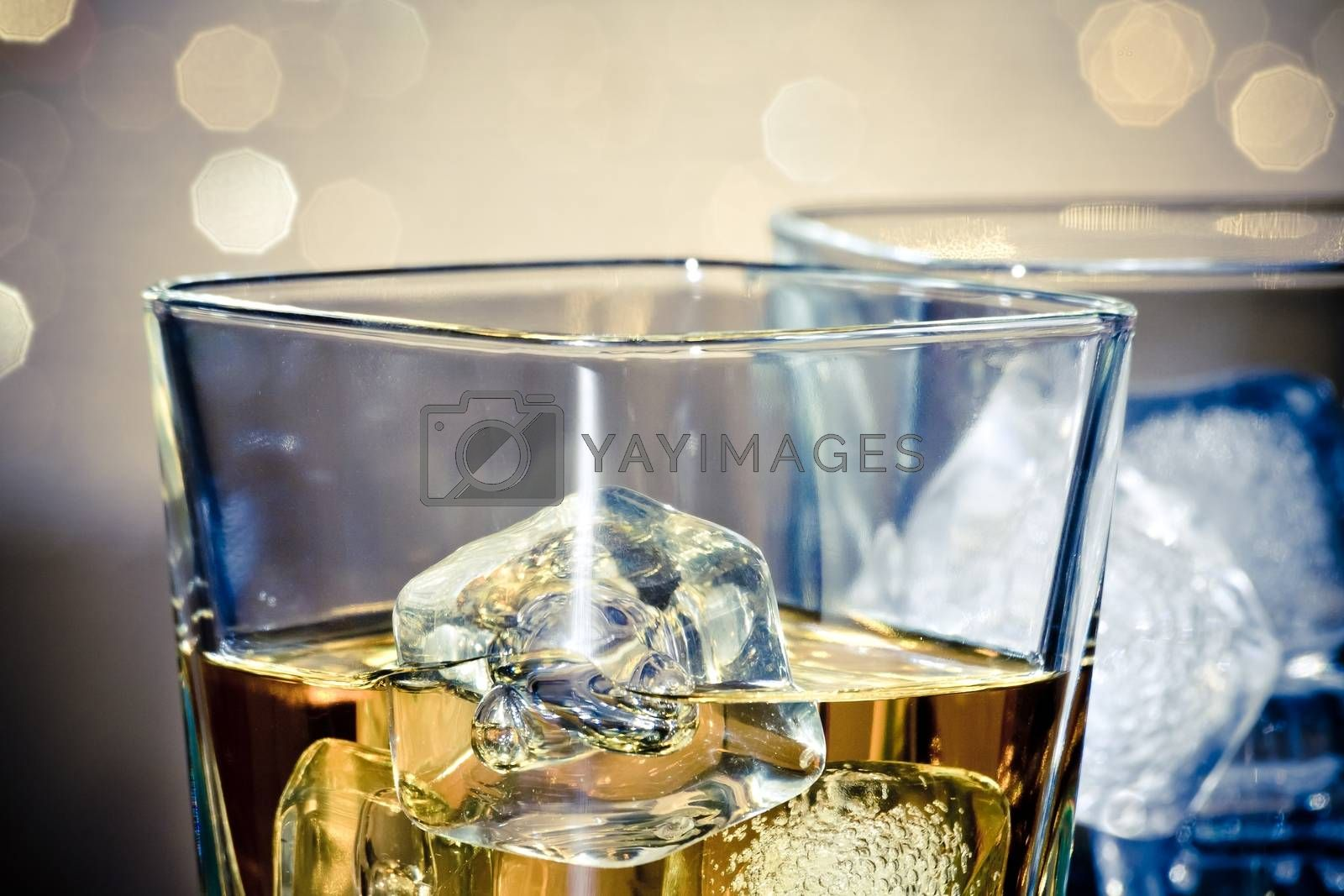 close-up of whiskey glasses by donfiore