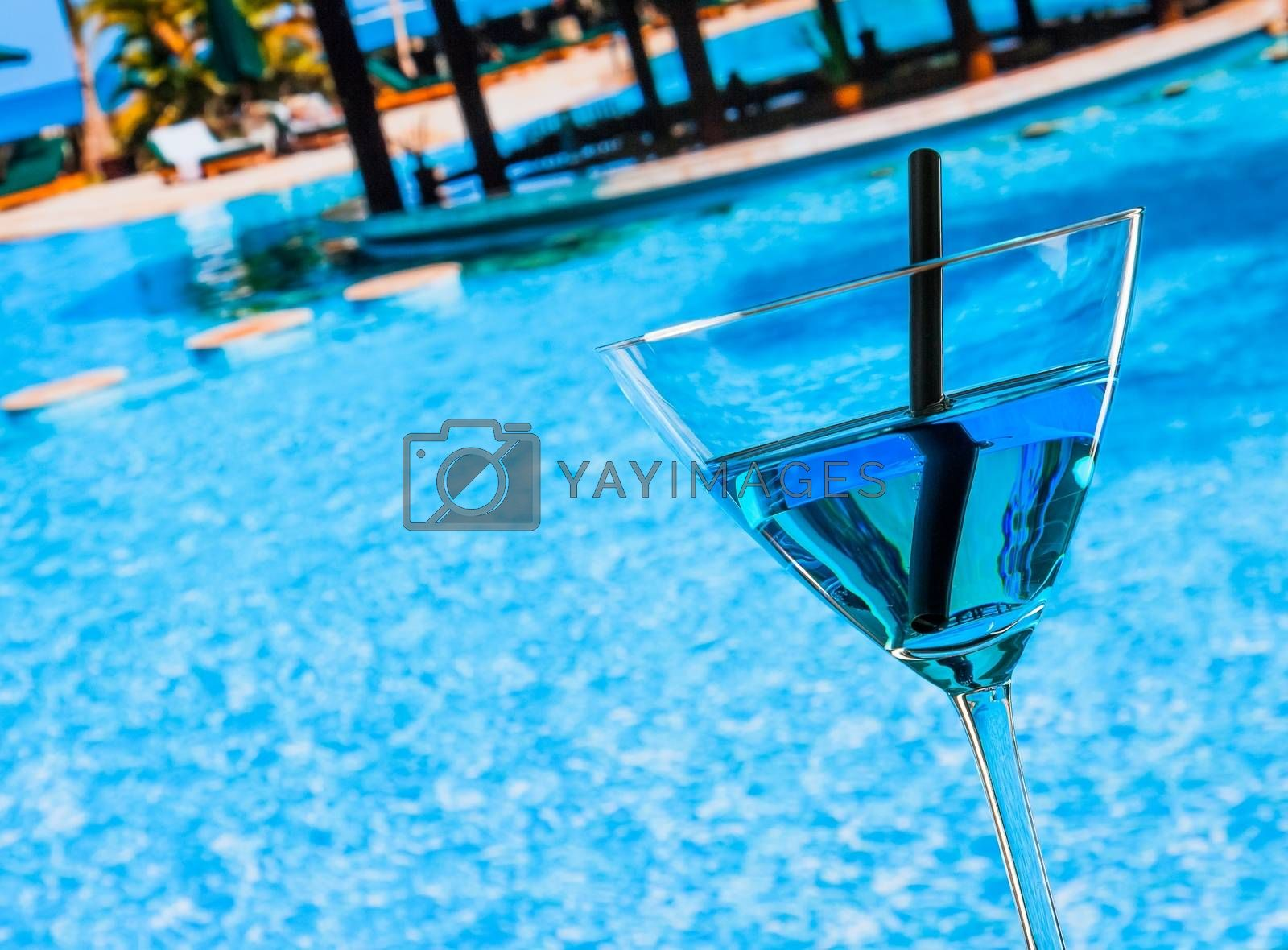 Cold blue cocktail near pool by donfiore