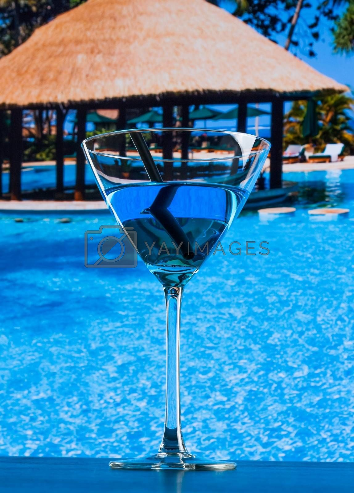 fresh blue cocktail near pool by donfiore