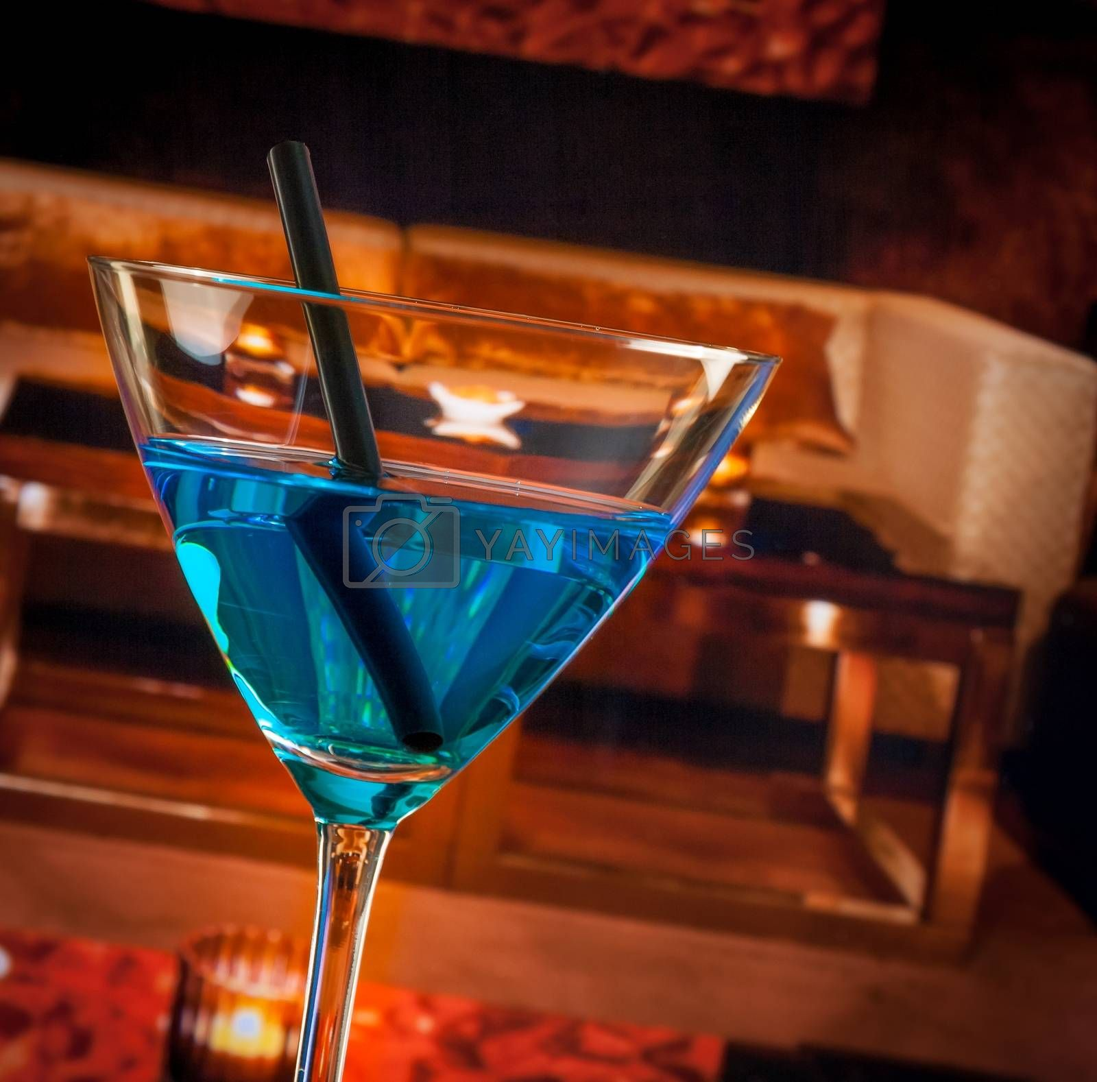 detail of blue cocktail drink on a lounge bar table by donfiore
