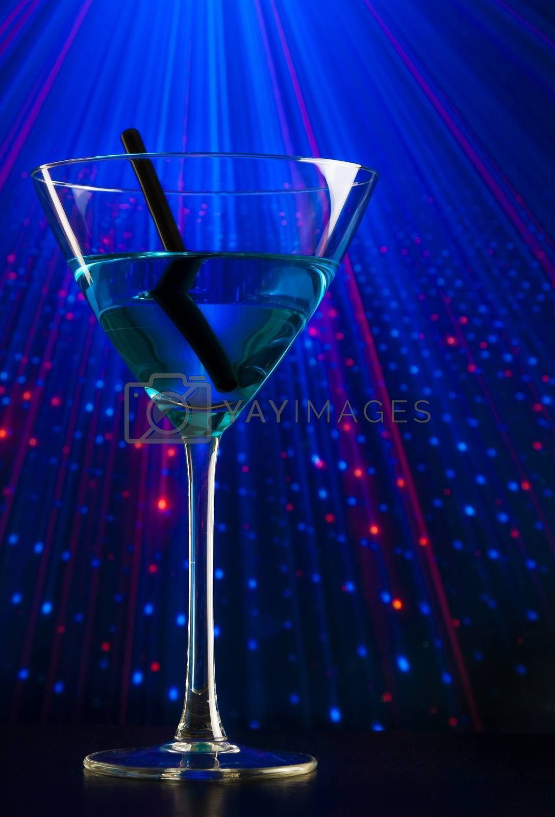 blue cocktail drink in a disco with space for text by donfiore