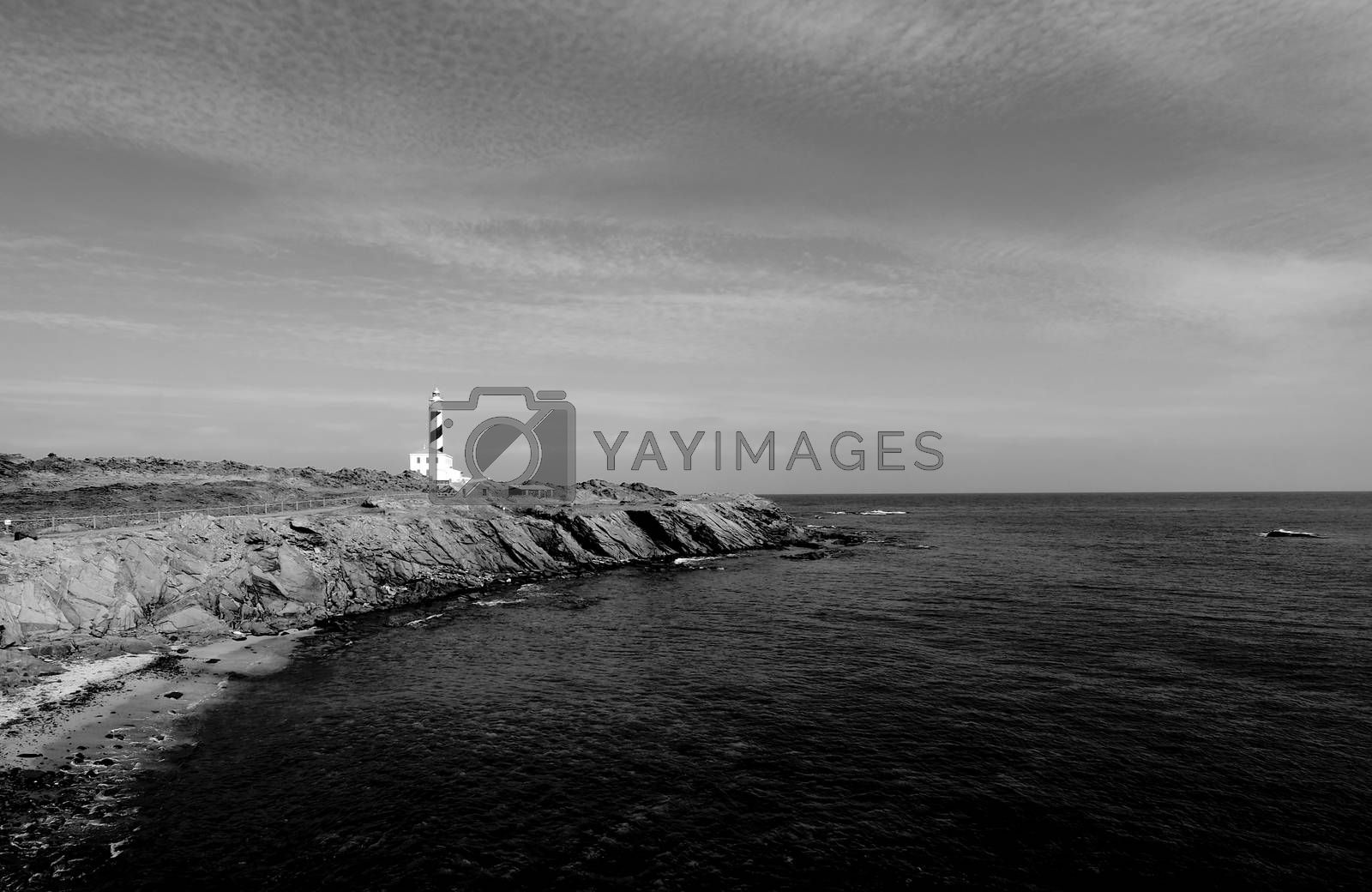 Lighthouse on Shore by zhekos