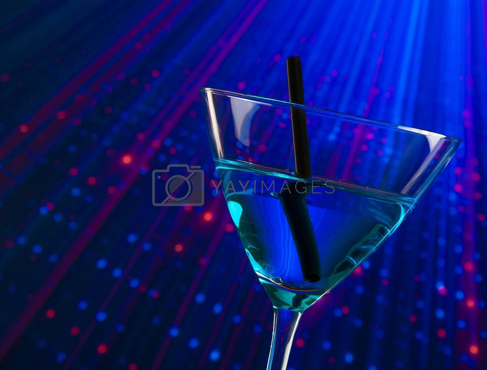 detail of blue cocktail drink in a disco with space for text by donfiore