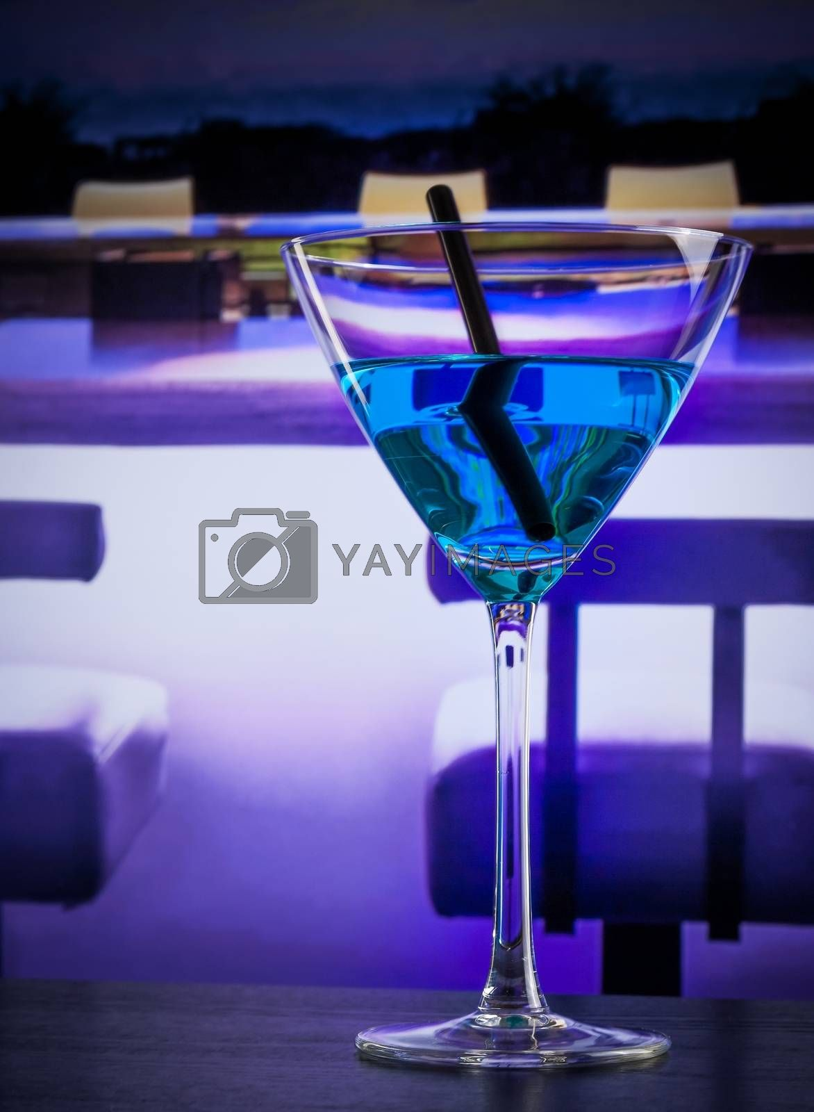 blue cocktail drink on a lounge bar table with space for text by donfiore