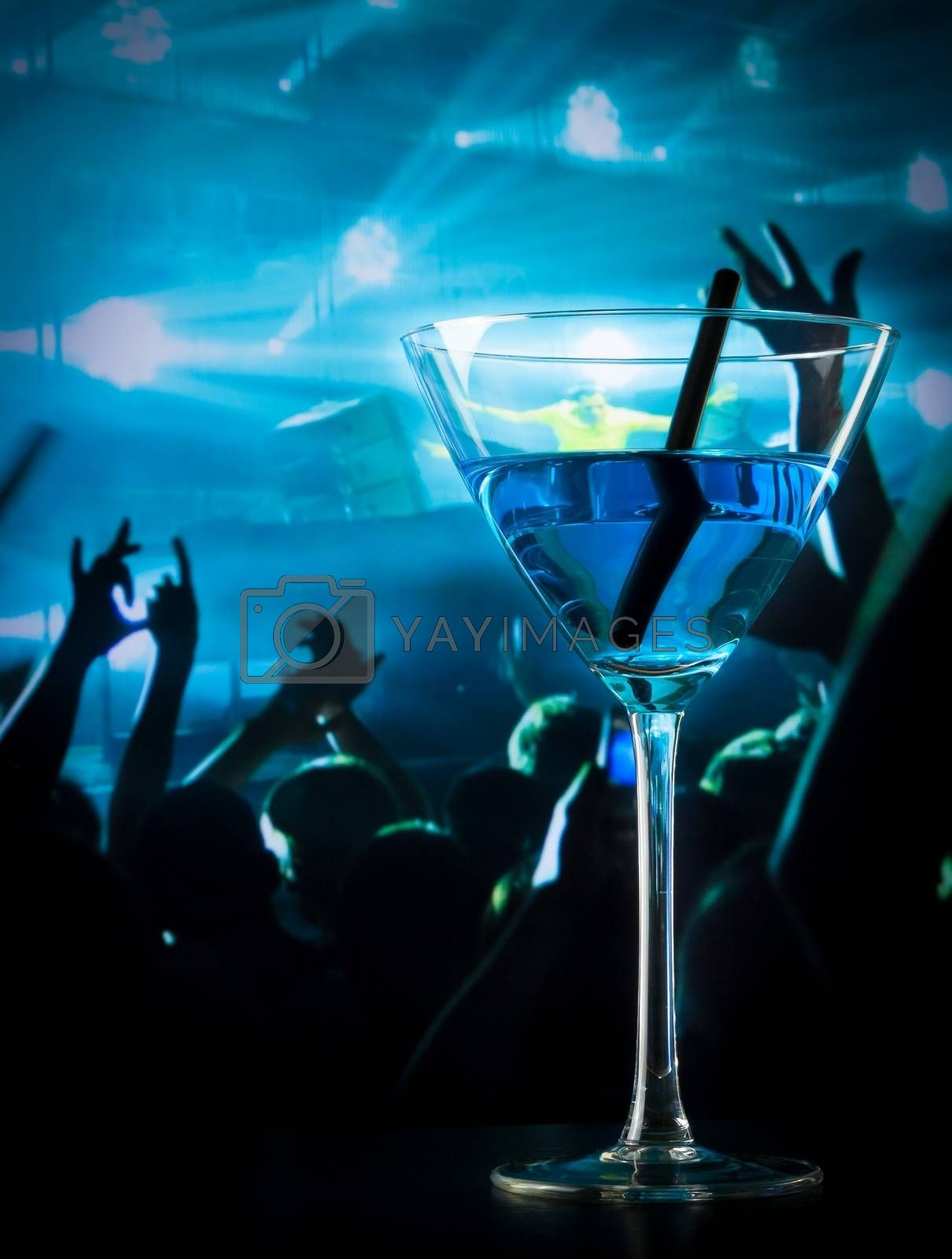blue cocktail drink on a disco table with space for text by donfiore