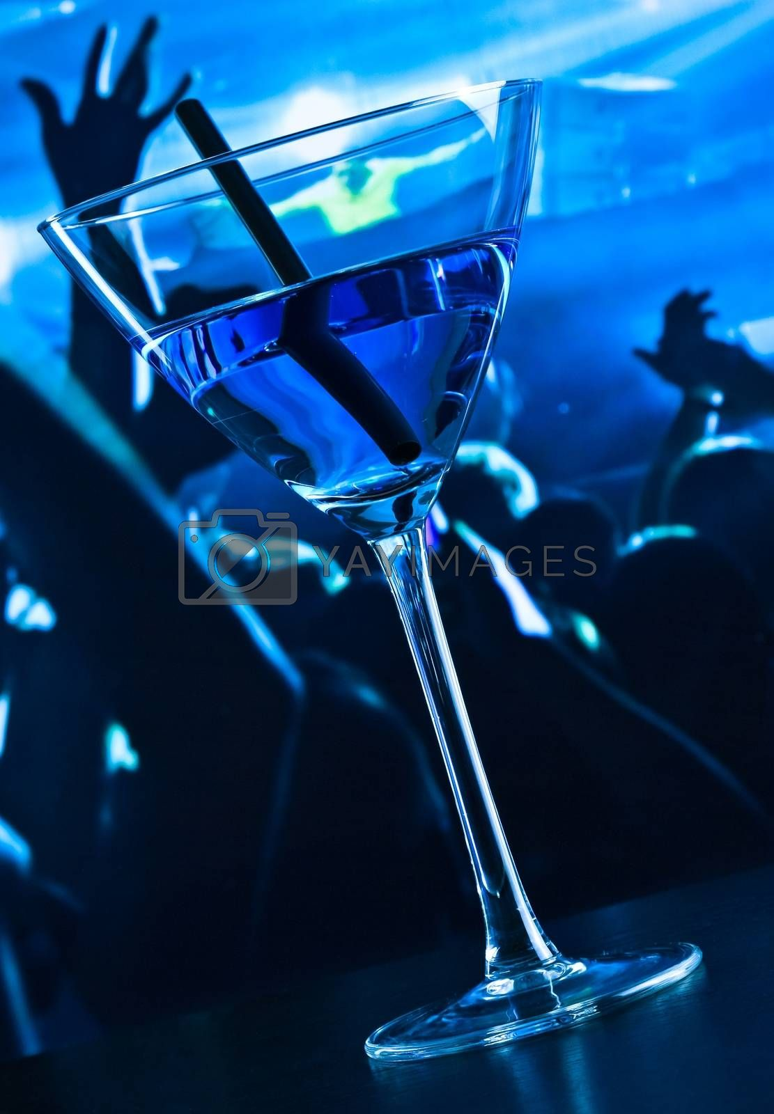 blue cocktail drink on a disco table by donfiore