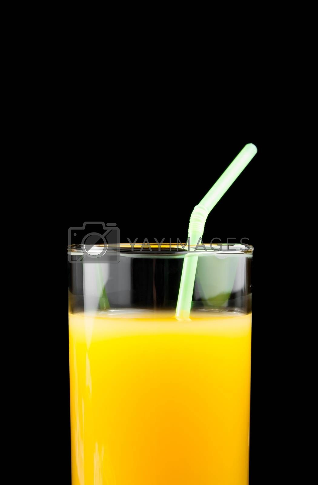 full glass of orange juice with straw and space for text by donfiore