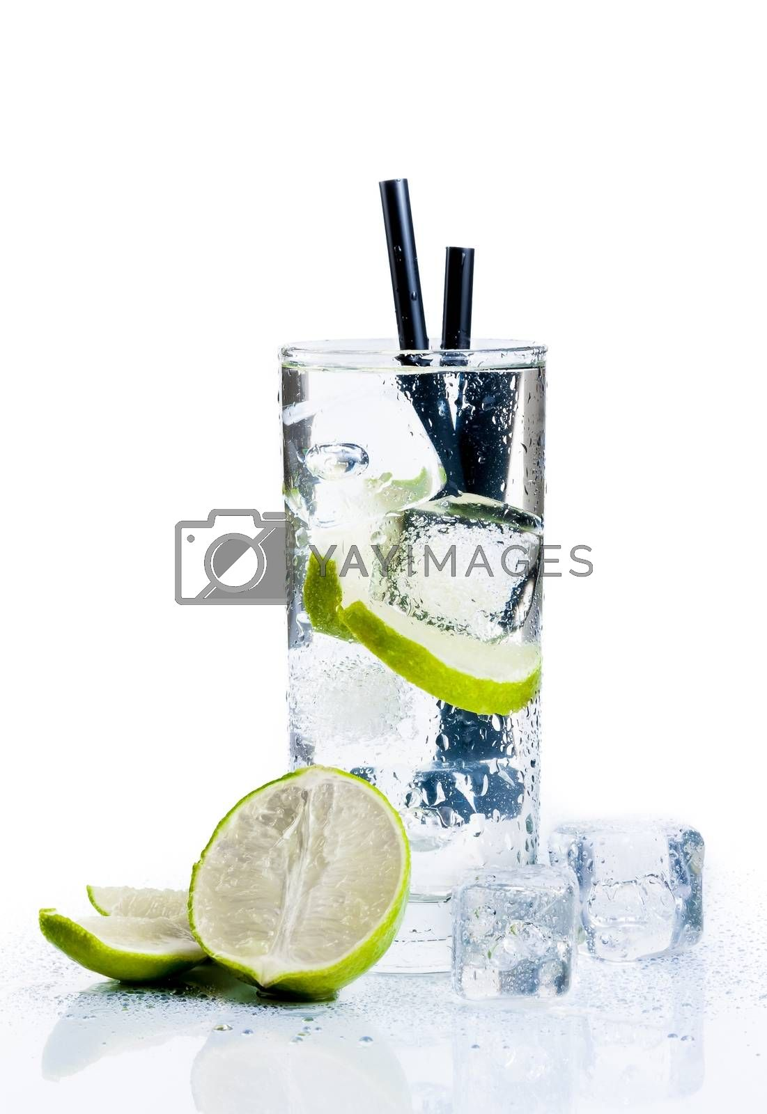 Cocktail with ice and lime slice isolated by donfiore
