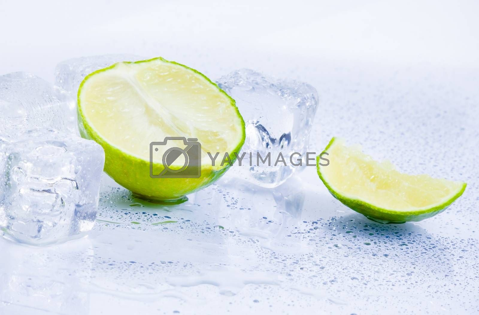 Ice cubes with fresh lime isolated on white by donfiore
